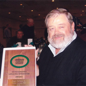 Roger Receiving Logging Award